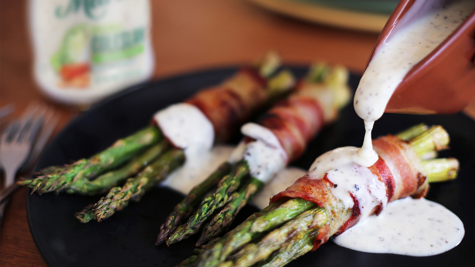 Asparagus with Bacon and Lemon Pepper Drizzle is made with Marie's Original Coleslaw Dressing.