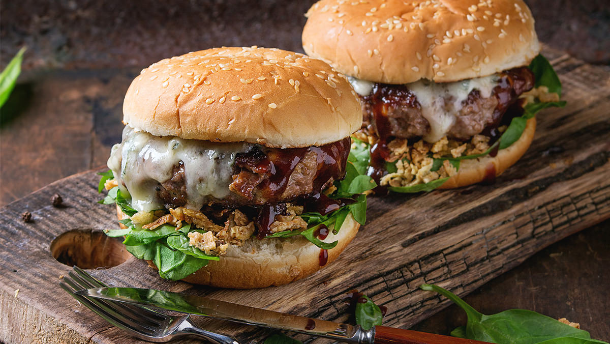 Burgers with Wing Sauce and Blue Cheese is made with Marie's Super Blue Cheese.