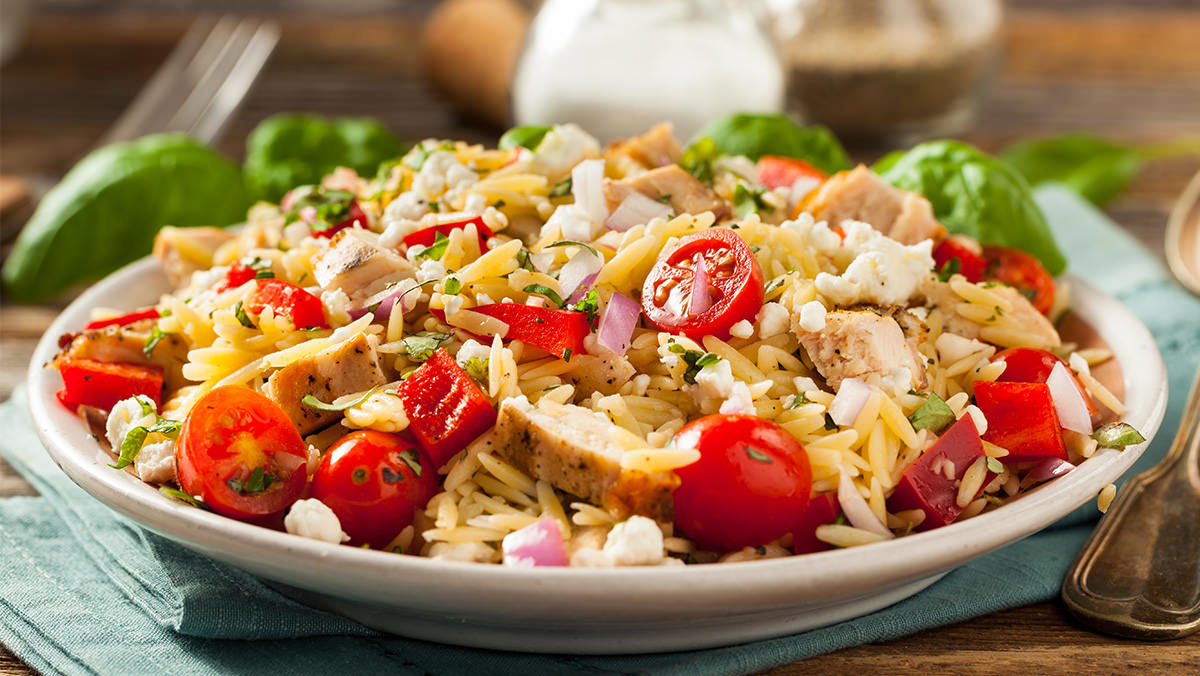 Creamy Italian Orzo and Tomato Salad is made with Marie's Creamy Italian Garlic Dressing.