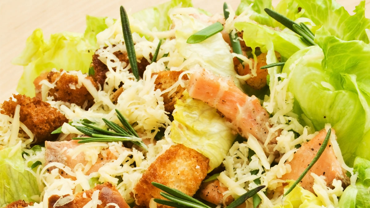Salmon Caesar Salad is made with Marie's Yogurt Parmesan Caesar Dressing.