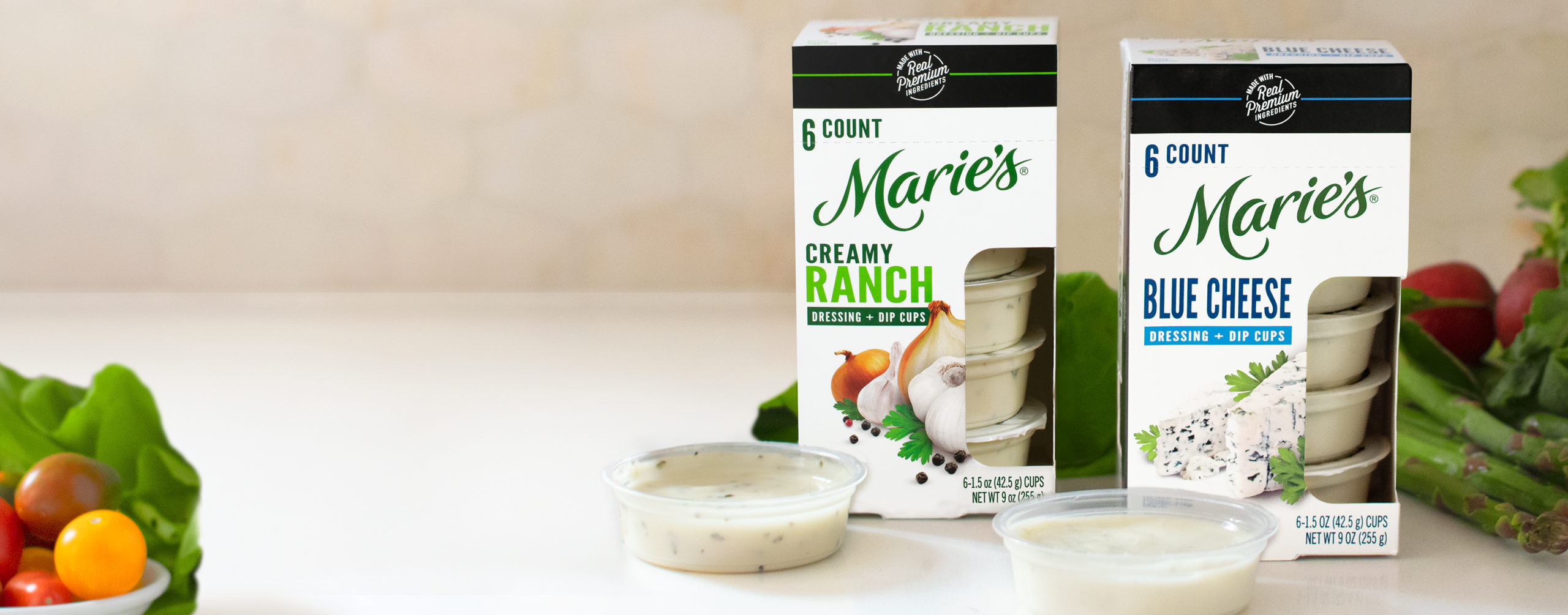 Marie's Dipping Cups, Blue Cheese and Creamy Ranch single-serving dipping cups perfect for on-the-go snacking.
